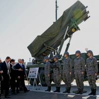 U.S. Vice President Mike Pence inspects PAC-3 missile interceptors with Defense Minister Itsunori Onodera at the Defense Ministry in Tokyo on Wednesday.   REUTERS