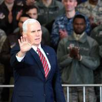 U.S. Vice President Mike Pence waves after addressing U.S. soldiers at Yokota Air Base on Thursday. | AFP-JIJI