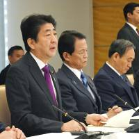 Prime Minister Shinzo Abe speaks during a Tokyo conference on the aging of society at the Prime Minister's Office on Friday. | KYODO
