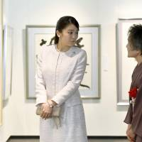Princess Mako attends a calligraphy exhibition in Tokyo on Friday in her first official appearance since news of her marriage delay was made public. | KYODO