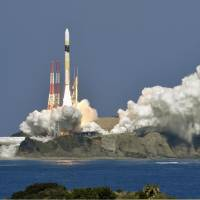 An H-IIA F38 rocket is launched Tuesday from a Japan Aerospace Exploration Agency facility in Kagoshima Prefecture. | KYODO