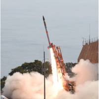 The world's smallest satellite-carrying rocket is launched Saturday at the Uchinoura Space Center in Kagoshima Prefecture. | JAPAN AEROSPACE EXPLORATION AGENCY / VIA KYODO