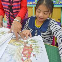 A student at an elementary school in Taiwan's Yilan County attends a lesson on the Atayal language on Dec. 19. | KYODO