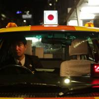Revolution looms for Japan's staid taxi sector as Uber and SoftBank vie for a piece of the action