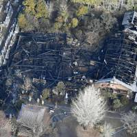 An aerial photo taken Friday shows the gutted main building and priests' quarters of Jomanji Temple in Inuyama, Aichi Prefecture. | KYODO