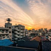 Homes in Arakawa Ward's Yanaka Ginza district. It's one of the areas in Tokyo that is concentrated with old wooden houses and light-gauge steel buildings. | GETTY IMAGES