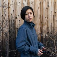 Mayuko Uemura, who came up with the idea for 'Tabi Kaeru,' poses for a photo in Kyoto in January. | BLOOMBERG