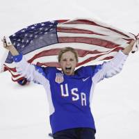 Jocelyne Lamoureux-Davidson celebrates after the U.S. team won the gold medal against Canada in women's ice hockey on Feb. 22. | AP