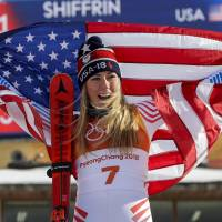 Mikaela Shiffrin, of the United States, celebrates her gold medal during the venue ceremony of the women's giant slalom on Feb. 15. | AP