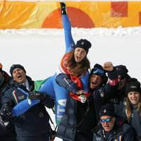 Gold medal winner Sofia Goggia, of Italy, celebrates after the venue ceremony for the women's downhill on Feb. 21. | AP