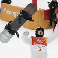 Shaun White, of the United States, celebrates winning the gold medal in the men's halfpipe finals  on Feb. 14. | AP