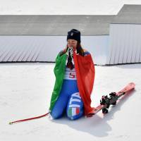 Italy's Sofia Goggia celebrates during the victory ceremony of the women's downhill skiing on Feb. 21. | AFP-JIJI