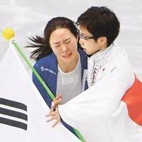 Speedskater Nao Kodaira (right) lived up to the hype by winning gold in the women's 500 meters, then comforted South Korean rival Lee Sang-hwa in a show of sportsmanship afterward. | REUTERS