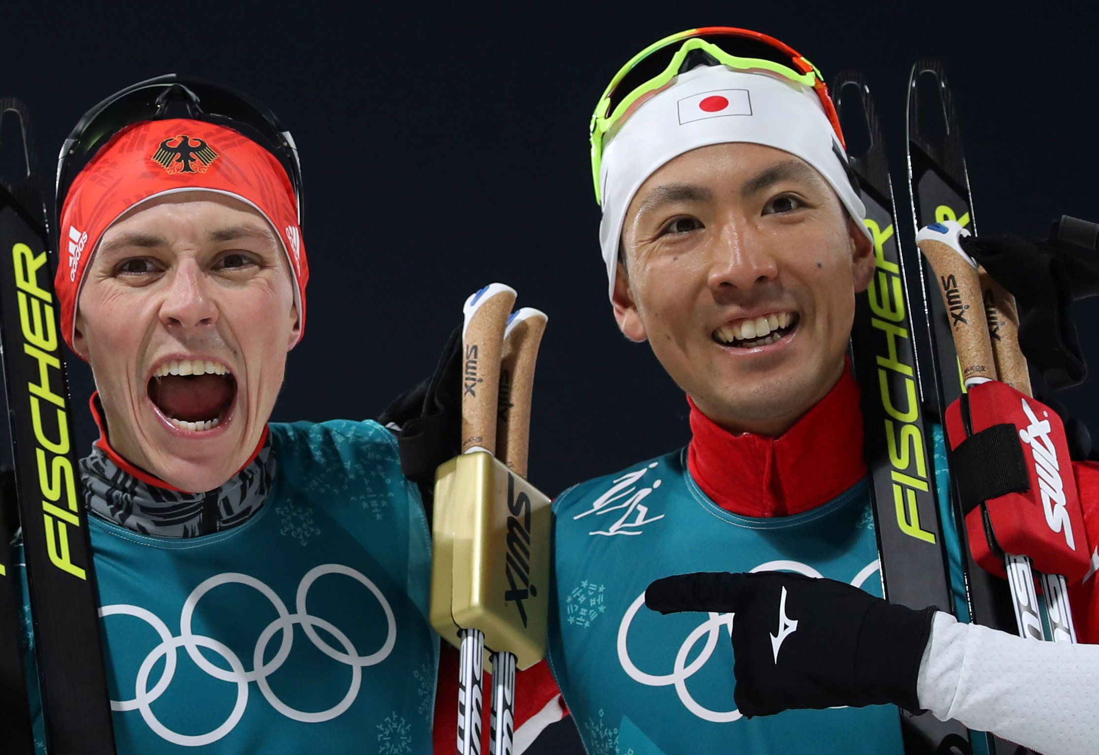 Eric Frenzel of Germany and Akito Watabe celebrate after crossing the finish line. | REUTERS