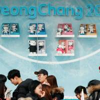 Visitors queue to buy Pyeongchang 2018 Winter Olympics merchandise from a store in the Gangneung Olympic Park, in Gangneung, South Korea February 19, 2018.     REUTERS/John Sibley