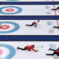 Curling - Pyeongchang 2018 Winter Olympics - Men's Round Robin - Gangneung Curling Center - Gangneung, South Korea - February 19, 2018 - Curlers practice and warm up on curling sheets ahead of session 9 of the Men's Round Robin. REUTERS/Toby Melville