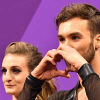 France's Gabriella Papadakis and France's Guillaume Cizeron react after competing in the ice dance short dance of the figure skating event during the Pyeongchang 2018 Winter Olympic Games at the Gangneung Ice Arena in Gangneung on February 19, 2018. / AFP PHOTO / Mladen ANTONOV