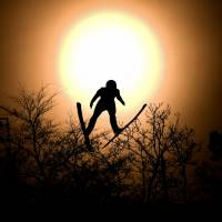 Italy's Alessandro Pittin flies through the sun disk during the nordic combined men's individual Gundersen LH/10km. | AFP-JIJI