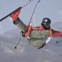 Canada's Mike Riddle competes in a run of the men's ski halfpipe final. | AFP-JIJI