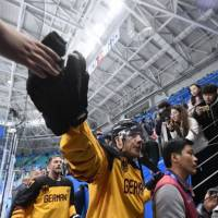 German players greet fans after they won the men's semi-final ice hockey match between Canada and Germany. | AFP-JIJI
