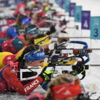 France's Marie Dorin Habert competes at the shooting range in the women's 4x6km biathlon event. | AFP-JIJI