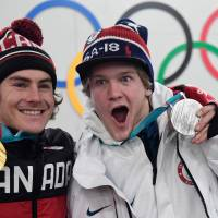 Canadian gold medalist Sebastien Toutant  (left) and U.S. silver medalist Kyle Mack pose with their medals backstage at the Athletes' Lounge during the medal ceremonies at the Pyeongchang Medals Plaza. | AFP-JIJI