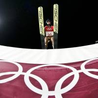 Kamil Stoch of Poland leaves the jump tower during the men's normal hill individual ski jumping competition on Saturday. | AFP-JIJI