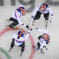 The South Korea team hold hands before winning the women's 3,000m relay short track speed skating heat event during the Pyeongchang 2018 Winter Olympic Games on Saturday. | AFP-JIJI