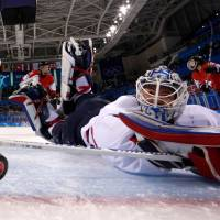Unified Koreaís goalkeeper Shin So-jung watches the puck go into the goal shot by Switzerland's Phoebe Staenz (88) during the women's preliminary round ice hockey match between Switzerland and the Unified Korean team at the Kwandong Hockey Centre in Gangneung, South Korea. | AFP-JIJI