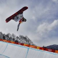 ChloeKim, of the United States, runs the course during the women's halfpipe qualifying at Phoenix Snow Park at the 2018 Winter Olympics in Pyeongchang, South Korea, Monday, Feb. 12, 2018. (AP Photo/Kin Cheung) | AP