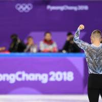 TOPSHOT - USA's Adam Rippon reacts after competing in the figure skating team event men's single skating free skating during the Pyeongchang 2018 Winter Olympic Games at the Gangneung Ice Arena in Gangneung on February 12, 2018. / AFP PHOTO / Roberto SCHMIDT | AFP-JIJI
