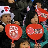 Fans of Japan's ice hockey team cheer at the Switzerland vs Japan game.  | REUTERS