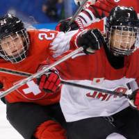 Isabel Waidacher of Switzerland and Mika Hori of Japan in action. | REUTERS