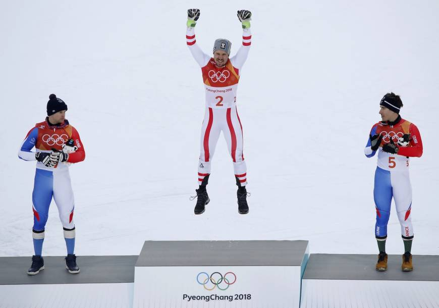 Alexis Pinturault of France, Marcel Hirscher of Austria, and Victor Muffat-Jeandet of France react during the men