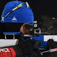 France's Martin Fourcade competes at the shooting range to win gold in the men's 12.5km pursuit biathlon event. | AFP-JIJI