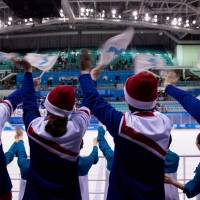 North Korean cheerleaders wave the Unified Korea flags after the women's preliminary round ice hockey match between Sweden and Unified Korea at the Kwandong Hockey Centre. | AFP-JIJI