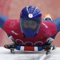 Lizzy Yarnold of Britain in action during the women's skeleton training at the Olympic Sliding Centre. | REUTERS