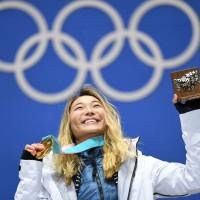 Gold medalist Chloe Kim poses on the podium during the medal ceremony for the snowboard women's halfpipe at the Pyeongchang Medals Plaza on Tuesday.  | AFP-JIJI