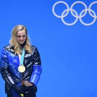 Sweden's gold medallist Stina Nilsson cries of joy on the podium during the medal ceremony for the women's cross country sprint classic at the Pyeongchang Medals Plaza. | AFP - JIJI
