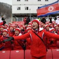 North Korean cheerleaders sing as the Alpine Skiing Women's Slalom was cancelled due to weather conditions at the Jeongseon Alpine Center. | AFP - JIJI