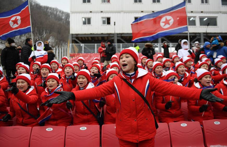 North Korean cheerleaders sing as the Alpine Skiing Women