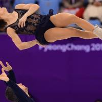 Canada's Meagan Duhamel and Eric Radford compete in the pair skating short program of the figure skating event. | AFP-JIJI