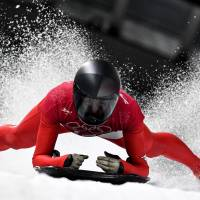 Austria's Janine Flock takes part in the women's skeleton training session at the Olympic Sliding Centre. | AFP - JIJI