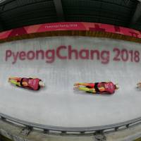 A multi-exposure picture shows Germany's Alexander Gassner in his men's skeleton training session at the Olympic Sliding Centre. | AFP - JIJI