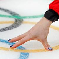 A close up of the nails of Eve Muirhead of Britain at the curling women's round robin event between Britain and the U.S. | REUTERS