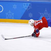 Mattias Norstebo of Norway falls as he is tripped during the first period of the Norway v Sweden ice hockey men's preliminary round match at the Gangneung Hockey Centre. | REUTERS