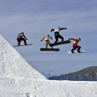 KalleKoblet of Switzerland, JanKubicik of the Czech Republic, KonstantinSchad of Germany, KevinHill of Canada, and AlessandroHaemmerle of Austria run the course during the men's snowboard cross elimination round at Phoenix Snow Park. | AP