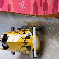 Nico Walther of Germany corners in his men's two-man bobsleigh training session at the Olympic Sliding Centre. | AFP-JIJI