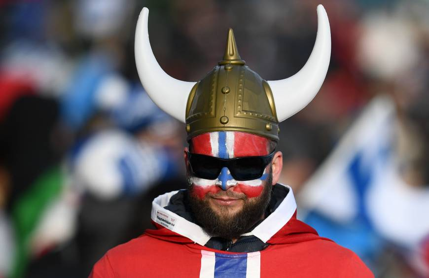 A Norwegian fan reacts as Norway win gold and bronze in the women