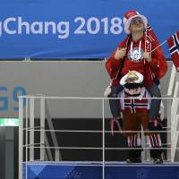 Norway supporters wait before the second period of the preliminary round of the men's hockey game between Norway and Sweden. | AP